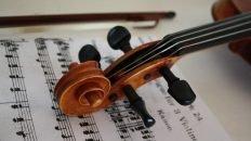 violin scroll on music